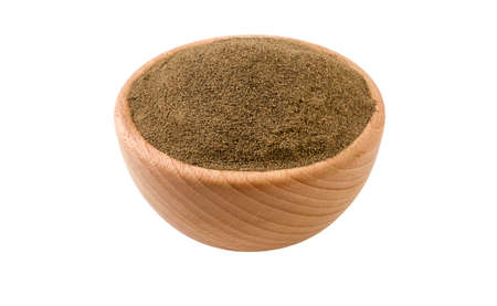 milled or ground black pepper in wooden bowl isolated on white background. 45 degree view. Spices and food ingredients.