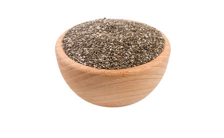 chia seeds in wooden bowl isolated on white background. 45 degree view. Spices and food ingredients. Stock Photo