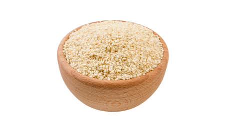sesame seeds in wooden bowl isolated on white background. 45 degree view. Spices and food ingredients.