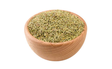 rosemary leaves in wooden bowl isolated on white background. 45 degree view. Spices and food ingredients.