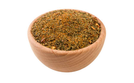 red savory mix or Chubritsa in wooden bowl isolated on white background. 45 degree view. Spices and food ingredients.