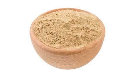 cardamon powder in wooden bowl isolated on white background. 45 degree view. Spices and food ingredients. Stock Photo