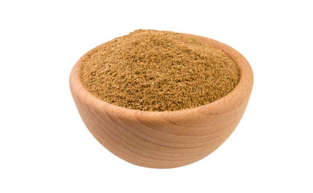 Ground or milled Caraway in wooden bowl isolated on white background. 45 degree view. Spices and food ingredients.