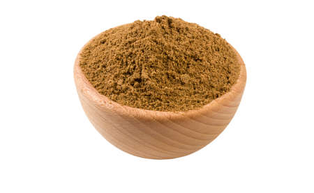 garam masala mix in wooden bowl isolated on white background. 45 degree view. Spices and food ingredients. Stock Photo