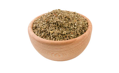 salvia or sage in wooden bowl isolated on white background. 45 degree view. Spices and food ingredients. Stock Photo