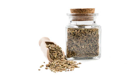 anise seeds in wooden scoop and jar on isolated on white background. front view. spices and food ingredients.