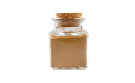 ground or milled cinnamon in glass  jar on isolated on white background. front view. spices and food ingredients. Stock Photo