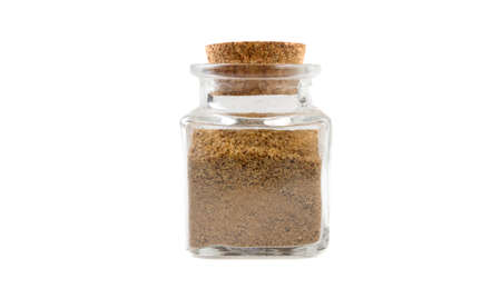 Ground or milled Caraway in glass  jar on isolated on white background. front view. spices and food ingredients. Stock Photo