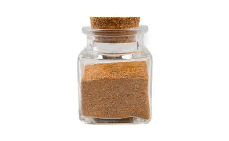 herb or herbal pepper mix in glass  jar on isolated on white background. front view. spices and food ingredients. Stock Photo