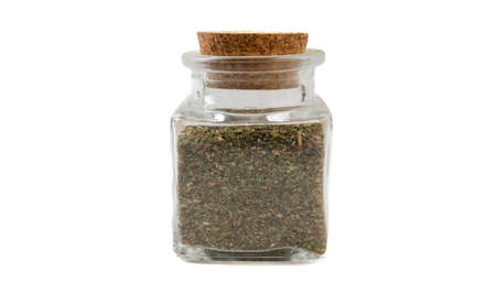 green savory mix or Chubritsa in glass  jar on isolated on white background. front view. spices and food ingredients. Stock Photo