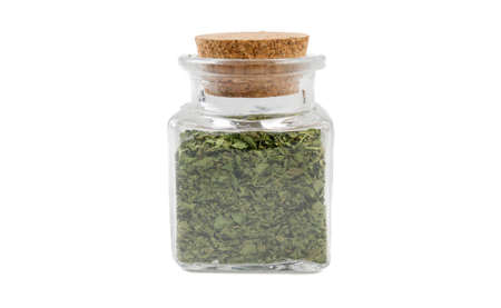 coriander leaves in glass  jar on isolated on white background. front view. spices and food ingredients.