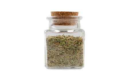 rosemary leaves in glass  jar on isolated on white background. front view. spices and food ingredients.