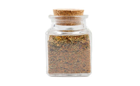 red savory mix or Chubritsa in glass  jar on isolated on white background. front view. spices and food ingredients.