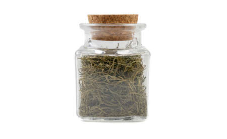 dill in glass  jar on isolated on white background. front view. spices and food ingredients.