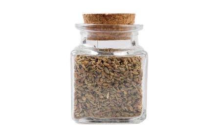 anise seeds in glass  jar on isolated on white background. front view. spices and food ingredients. Stock Photo