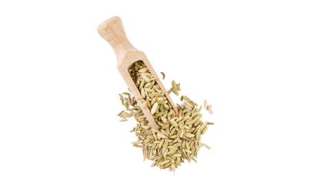 fennel seeds in wooden scoop isolated on white background. top view. spices and food ingredients. Stok Fotoğraf