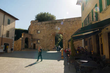 San Quirico d'Orcia, Siena / Italy-September 20 2018: Alley of the characteristic medieval village of San Quirico d'Orcia, a town of ancient Etruscan origins in Siena, Tuscany Italy