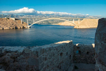 Bridge to the island of Pag, a Croatian island in the Adriatic Sea and connected by the bridge with the mainland. View on a Pag bridge from an old fortress