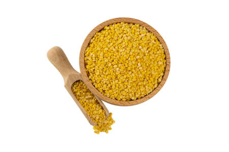 Mung dal or Mung daal bean in wooden bowl and scoop isolated on white background. nutrition. bio. natural food ingredient.