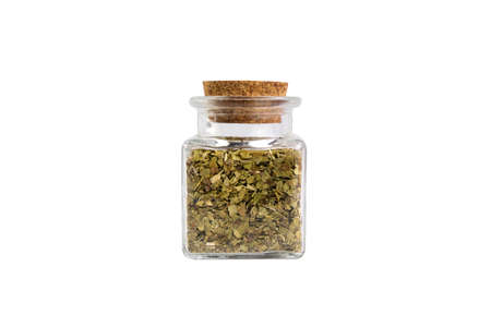 Dried leaves of yerba mate tea in a glass jar isolated on white background. Nutrition. Traditional tea in South-America. Фото со стока