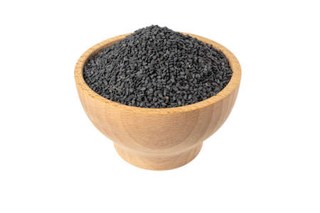 Black Sesame seeds in wooden bowl isolated on white background. Spices and food ingredients.
