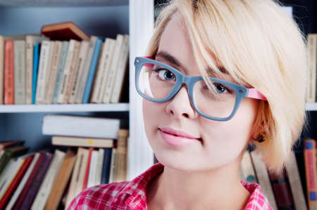 cute blonde student girl with glasses photo