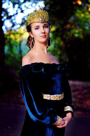 velvet dress: Elegant young woman dressed like queen with a crown