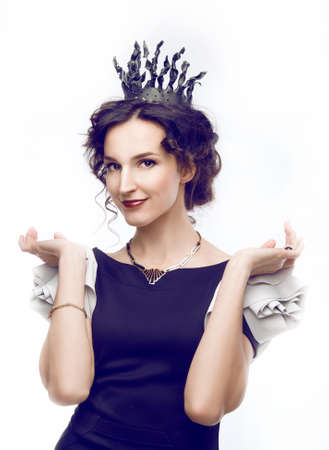 bossy: Studio portrait of a beautiful bossy brunette with a crown