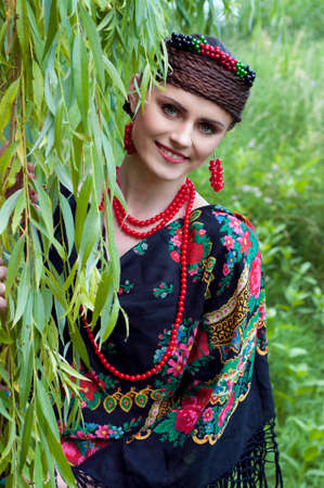 boyar: Happy smiling  slavonic woman near the willow tree
