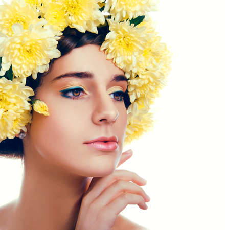 glowing skin: Girl with flower wreath. Caucasian woman with yelloe chrysanthemum flowers suntanned glowing skin and  brown hair close up on white background