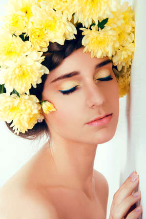 glowing skin: Girl with flower wreath. Caucasian woman with suntanned glowing skin and  brown hair close up. Stock Photo