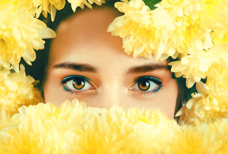 brown eyes: Caucasian woman with brown eyes with yellow flowers wreath around her head