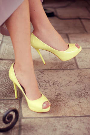 opentoe: Feminine legs in yellow open-toe pumps
