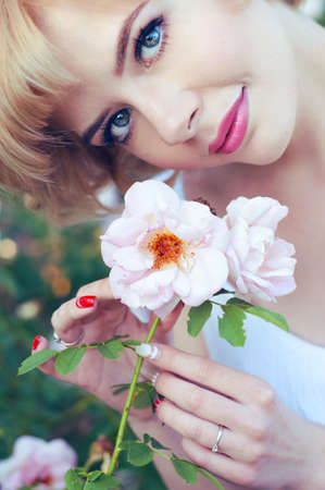 pink lips: Beautiful blonde woman with pink lips holding a white rose Stock Photo
