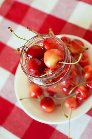 sweet treats: Summer rainier cherries in a glass bowl on a tablecloth. Sweet treats. Stock Photo