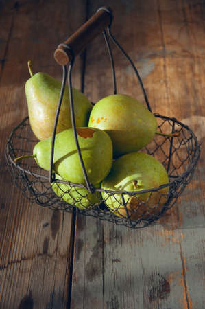 washed: Fresh washed pears with water drops in a basket