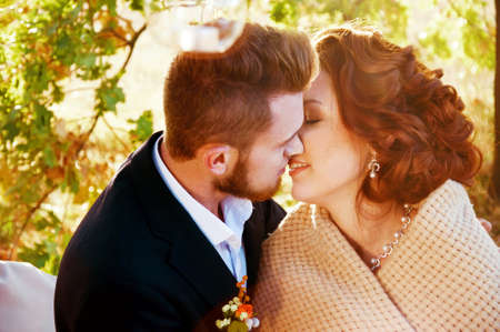 newly weds: Newly weds going to kiss. Outdoor romantic scene. Stock Photo