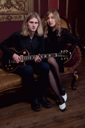 lovers quarrel: Handsome young couple of musicians boyfriend and girlfriend with blond hair Stock Photo