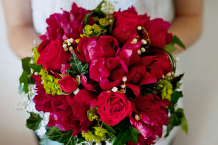 magenta dress: Fresh bridal bouquet. Deep red summer flowers, roses, peonies,  lilies of the valley.