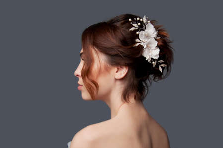 bare woman: Elegant bride with brown short hair updo and bare shoulders white wedding dress
