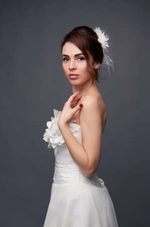 updo: Elegant bride with brown short hair updo and bare shoulders white wedding dress