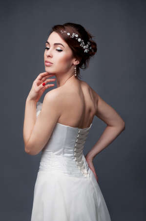 headpiece: Bridal fashion, hairstyle and makeup. Brunette bride in wedding dress and beaded headpiece.