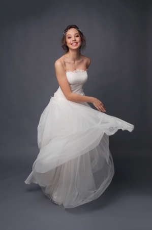 strapless dress: Happy smiling bride wearing white wedding lace strapless dress