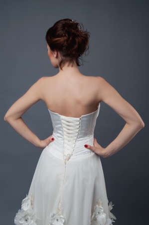 strapless dress: Bridal fashion. View from the back. Strapless dress with lacing.