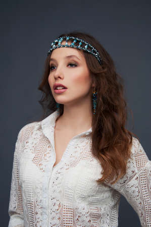 headpiece: Cute woman with brown eyes wearing beaded headpiece and earrings Stock Photo
