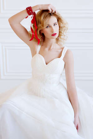 provocative: Beautiful blond bride with provocative red lips