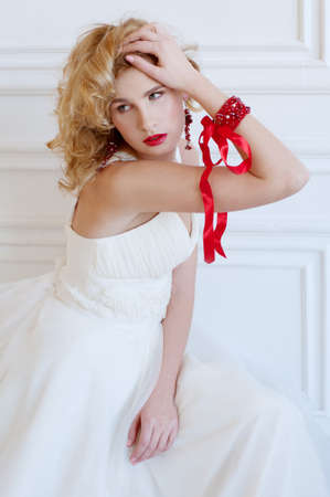 semi precious: Beautiful blond bride with provocative red lips and red semi precious jewelry