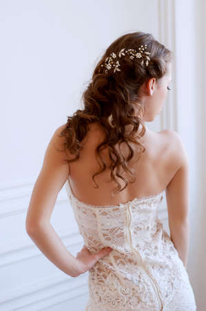 headpiece: Princess style bride wiyh long brown hair with crystal headpiece and earrigs