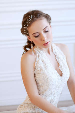 adult mermaid: Princess style bride with long brown hair with crystal headpiece and earrings Stock Photo