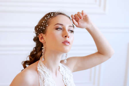 headpiece: Princess style bride with long brown hair with crystal headpiece and earrings Stock Photo